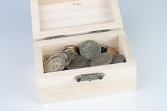 Coin in wooden box Stock Images