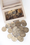 Coin in wooden box stock image