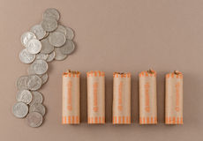 Coin-Wrapped and Loose Quarters Stock Photos