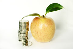 Coine with apple Royalty Free Stock Photo