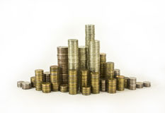 Coins 1. Tall columns of coins arranged like a city Royalty Free Stock Image