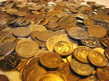 Coins 10. Golden coins on the table, background stock images