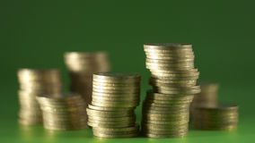 Coins. A group of coins on the green background royalty free stock image