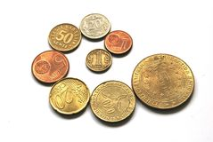 Coins. The some coins and the medal on the white background Royalty Free Stock Photos