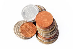 Coins. 3 columns of coins - Pound Sterling, US dollars and Japanese Yen. Focus on the top of the Pound Sterling column stock photography