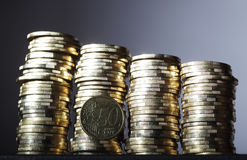 Coins. Four coin pile with 50 cent on dark background Royalty Free Stock Photos