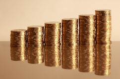 Coins. Six coin piles with reflection Royalty Free Stock Image