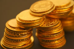 Coins. Gold coins on the dark background Royalty Free Stock Images