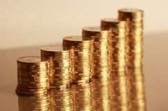 Coins. Six coin piles with reflection in gold color Royalty Free Stock Image