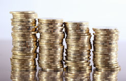 Coins. Four coin piles with reflection Royalty Free Stock Photo