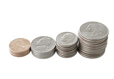 Coins. Quarters, dimes, nickels and penny coin stacks isolated on white Stock Photography