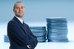 Coins. Coin representing company growth in a blue tone stock image