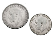 Coins. Old silver british coins with the king Georg V portrait stock photos