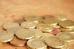 Coins. Some europeans coins in a brown background royalty free stock image