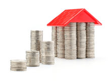 Coins. Stack of coins and money house with the red roof Royalty Free Stock Photo
