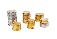 Coins. Stack of coins over a white background Royalty Free Stock Photography