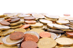 Coins. Many coins over a white background Royalty Free Stock Image
