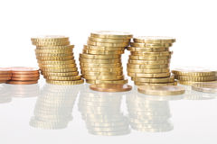 Coins. Picture of euro coins stacked, white  background Royalty Free Stock Image