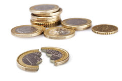Coins. Broken one euro coin on white Stock Image