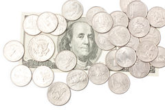 Coins. Heap of coins and a hundred dollar bill  on white Stock Photo