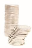 Coins. Two stacks of silver coins stock photos