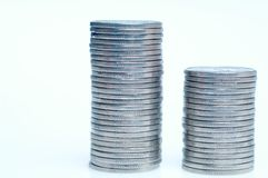 Coins. Two stacks of silver coins stock images