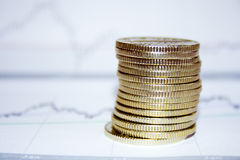 Coins. Pile on a stock chart Stock Photography