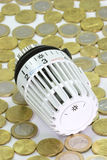 Coins. Thermostat with euro coins in background royalty free stock photos