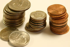 Coins. Three piles of coins stock photo