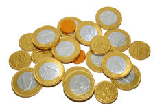 Coins. Against white background symbolizing growing wealth stock photos