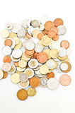 Coins. A heap of colorful coins on white background Royalty Free Stock Photos