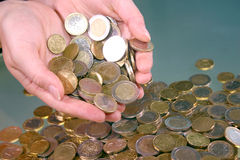 Coins. Hand full of money Royalty Free Stock Images