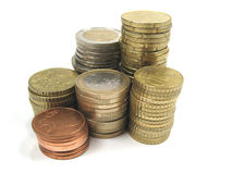Coins. Stacks of shiny and gleaming coins Royalty Free Stock Image