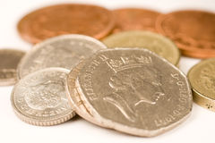 Coins. Fifty pence piece and other british coins Royalty Free Stock Photos