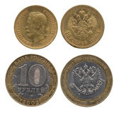 Coins. Russian gold coin of 10 roubles of 1899 and coin of 2002 royalty free stock images