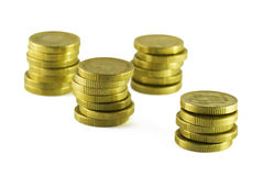 Coins. 4 piles of gold coins Stock Photography