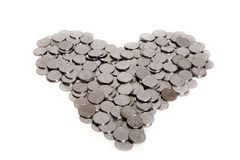 Coins. Heart arranged with coins isolated on white stock photo