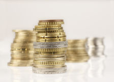 Coins. Some euro coins made towers royalty free stock photography