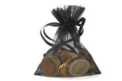 Coins. Black bag of coins isolated on white background Stock Photo