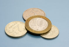 Coins. Gruppe coins on colored background royalty free stock photos