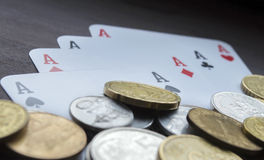 Coins and aces closeup Stock Photo