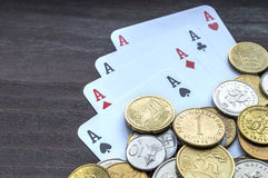 Coins and aces Stock Photo