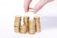 Coins added up by hand Royalty Free Stock Image