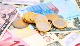 Coins against from banknotes Royalty Free Stock Photos
