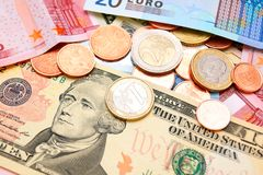 Coins against from banknotes Royalty Free Stock Images