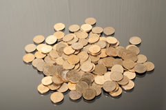 coins against a black background Stock Images