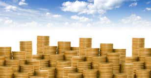 Coins against the blue sky Stock Photography