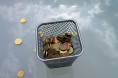 Coins against the blue sky and dark clouds..Euro coins. Coins against the blue sky and dark clouds. Coins in a container.A lot of coins and bills, euros, money stock photography