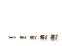 Coins against white background. Economic growth concept with coins Stock Image