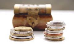 Coins against the wooden chest Royalty Free Stock Photography